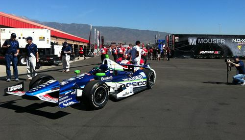 Tony Kanaan's No. 11 IndyCar gets towed out to pit row on qualification day. The cars cost a little more than $1 million, and the team budget for a year is roughly $7 million. By comparison, Formula One teams spend about $400 million a year racing. 