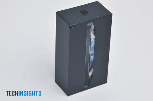 A look at the (slightly dented) packaging of the iPhone 5. Note the sleek black box, a departure from the traditional white packaging of Apple products.
