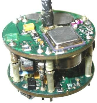 The PCB has dedicated power and ground planes on each board. The electronics package, including batteries, fits into a cylinder 28mm (1.1 inches) in diameter and 23mm (0.9 inches) in length.