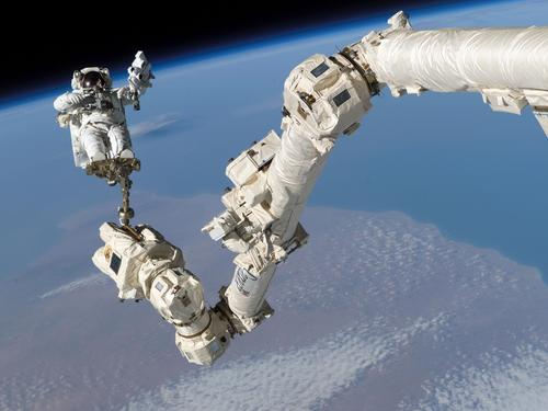 Canadarm2, the Space Station Remote Manipulator System (SSRMS), is the second-generation version of the Canadarm, which was Canada's contribution to the US space shuttle program. A 17.6m (57.7 ft) manipulator arm with seven motorized joints, Canadarm2 is used on the International Space Station (ISS) to conduct maintenance, move equipment and supplies, support astronauts working in space, and handle payloads attached to the space station. It also helped to construct the ISS. The arm handles large payloads and assists with docking the space shuttle. It can relocate itself with its latching end effector, attaching itself to multiple ports spread throughout the station's exterior surface. The Mobile Base System (MBS), a work platform that moves along rails along the length of the space station, gives the Canadarm2 lateral mobility.   (Source: NASA)