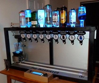 The machine comes with a Hitachi HD44780 compatible display to display drink information and buttons to navigate the menu. The Inebriator also boasts a stepper motor to drive the drink shelf, with acceleration and deceleration to allow high speed without spilling, and a DC motor to operate the optics.
