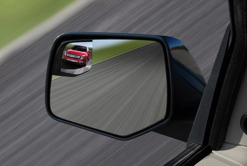 The Ford Escape employs Integrated Blind Spot Mirrors to make it easier for users to see 'blind spot drivers' while keeping their eyes on the road.   (Source: Ford Motor Co.)