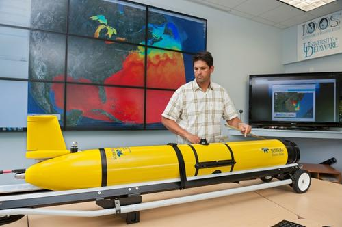An underwater robot based on the Slocum glider is tracking sand tiger sharks to help researchers understand shark migration patterns and behavior as it happens.   (Source: University of Delaware)