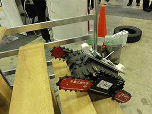 The Sakura, resembling a small tank, is designed to assess damage at the Fukushima Dai-Ichi nuclear reactor buildings, especially the basement areas. A key ability will be climbing stairs with changing slopes. (Source: Chiba Institute of Technology's Future Robotics Technology Center)