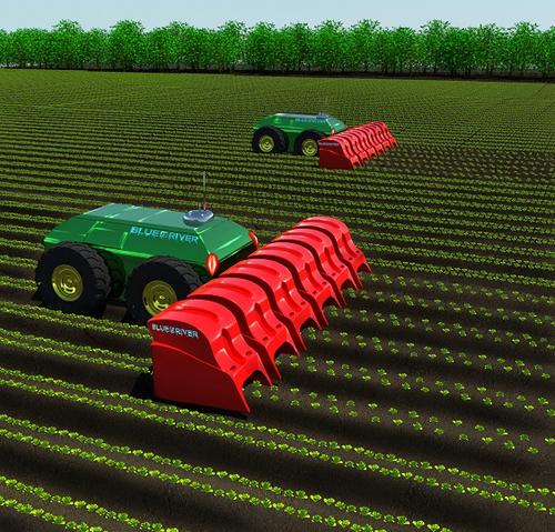 A robot being designed by computer vision and robotics company Blue River Technology will automate the backbreaking labor of weed pulling, eliminating the need to use harmful chemicals to kill weeds. The robotic weeder will employ image sensors in the implement (shown in red), as well as machine vision algorithms for recognizing and distinguishing among different types of plants.   (Source: Blue River Technology)