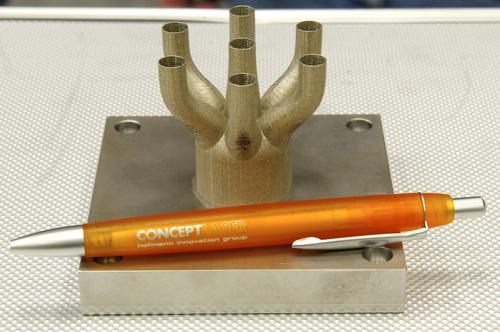 NASA is using 3D printing to build engine parts for its next-generation Space Launch System. Shown here is the first test piece produced on the M2 Cusing Machine at the Marshall Space Flight Center. (Source: NASA Marshall Space Flight Center/Andy Hardin)