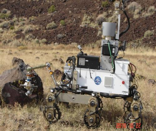 The CSA's Rex rover has a robotic arm that simulates collecting Martian rock and soil samples. It travels at 4cm/sec (1.57inch/sec). On its six aluminum or rubber wheels, the rover can navigate over obstacles up to 15cm (5.9 inches) high and climb slopes of up to 10 degrees. Rex weighs 140kg (308.64 pounds) and measures 152 x 142 x 76cm (59.84 x 55.9 x 29.92 inches). It can carry up to 30kg (66.13 pounds) of science payloads. In 2010, the CSA jointly field tested the rover with NASA at the Flagstaff Meteor Crater in Arizona. (Source: Canadian Space Agency)