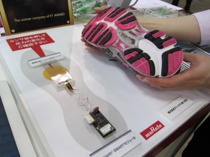 Murata Manufacturing showed off a running shoe embedded with clear piezo film devices and a Bluetooth smart module. Five small patches of piezo film placed on the sole can detect friction and foot movement inside the 'smart' shoe, allowing it to measure and help regulate the user's walking or running habits.