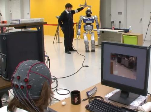 By focusing their attention on patterns created by flickering lights on a PC screen, which are associated with specific actions, users can control which actions they want a robot to perform, where the robot moves, and how it interacts with its environment.   (Source: CNRS-AIST Joint Robotics Laboratory)