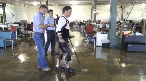 Chris Tagatac, who was paralyzed after a spinal cord injury suffered in July 2011, uses Ekso to walk.
