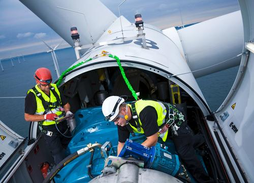 The costs of wind power are falling, not only for turbine cost and performance, but also for operating and maintaining wind farms. Shown here, Siemens service engineers work in a wind turbine's gondola.   (Source: Siemens)
