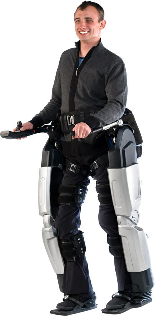 The Rex Exoskeleton lets people with impaired mobility (such as those confined to wheelchairs) stand up and walk. Patients use a control pad and a joystick to control 29 onboard processors that determine their balance and leg movements. The exoskeleton consists of a set of leg braces, straps, and a harness, all powered by a battery pack. With their hands free, users can stand, sit, turn, and walk on flat surfaces, slopes, and stairs. A fully charged battery pack allows walking for up to two hours. The exoskeleton, made by Rex Bionics of New Zealand, weighs 84 pounds (38kg). (Source: Rex Bionics)