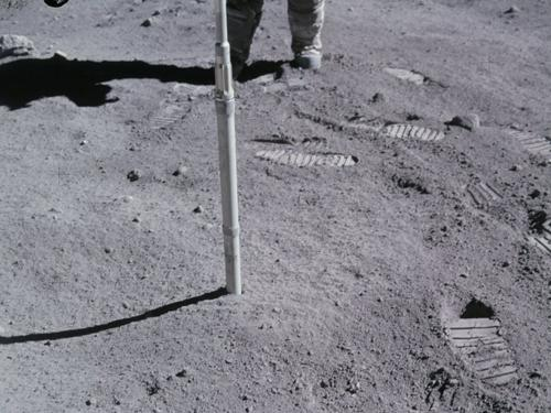 Washington State University engineers have 3D-printed some simple-shaped objects using a simulant of lunar regolith, a mixture of loose dust, rock, and soil that covers solid bedrock. Shown here, Apollo 16 astronaut Charlie Duke drives a core sample tube into the lunar regolith.   (Source: NASA)