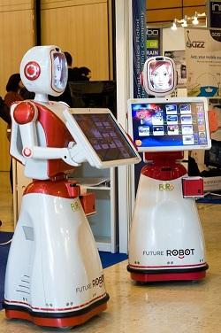 The FURO-Kis a friendly robotic kiosk. This bot moves about greeting people with a synthesized voice and explains its features. It is geared toward being a guide in public areas.  (Source: FURO)
