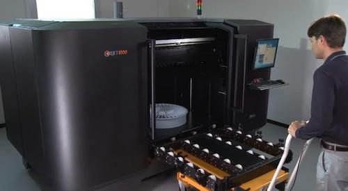 The Objet1000, the world's largest 3D printer as of December 2012, has a work envelope of 1,000mm x 800mm x 500mm at a 16 micron resolution. This image shows the scale of the Objet1000, definitely not something for the living room hobbyist.