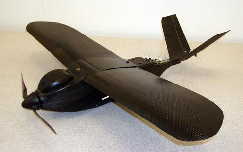 The Nighthawk Micro Air Vehicle (MAV) is a rugged, fully automated unmanned aerial vehicle (UAV) made of carbon fiber composite. It uses GPS and autopilot technologies for navigating unfriendly territories to conduct intelligence, surveillance, and reconnaissance missions. Its range is over 10 km (6 miles) and flight time is more than 60 minutes. The Nighthawk weighs 1.6 lb (725 gm), has a wingspan of 26 inches (66 cm), and a cruise speed of 18 to 30-plus knots. The MAV is equipped with 8-channel command and control, 4-channel video, and operates on batteries. It has forward and side-looking electro-optical cameras and a side or forward-looking thermal imager. A PC-based user interface provides real-time visual feedback and point-and-click waypoint navigation. The system can also be operated in semi-manual and manual flight modes. MAVs are stored fully assembled and ready to launch in a tube measuring 6 inches (15.2 cm) in diameter and attached to an assault pack. The assault pack's outer pockets hold a rugged laptop computer, the ground control station, and an antenna assembly. The pack's total weight is about 15 lb (6 kg).   (Source: Applied Research Associates)