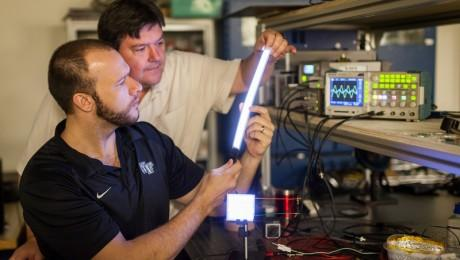 Wake Forest University scientists have devised a shatterproof, white light, flicker-free lighting device based on field-induced polymer electroluminescent (FIPEL) technology.   (Source: Wake Forest University)
