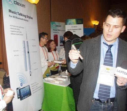 Dexim Santom USA showed several products, including the Music Talking Stylus, designed for use with iPhones and iPads. Besides serving as a touchscreen stylus, the pen communicates via Bluetooth with your smartphone and tablet, allowing users to listen wirelessly to both music and phone messages. The stylus comes with a built-in volume button.