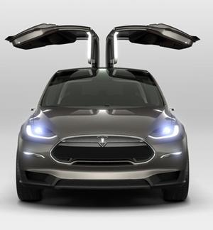 Tesla showed off the Model X, which is said to blend the qualities of a sport utility vehicle and a minivan in an all-electric car that's targeted to hit the streets in 2014. The car's 'falcon wing' doors use a hinge between the glass roof panel and the side, allowing them to open up but not out. (Source: Tesla Motors)