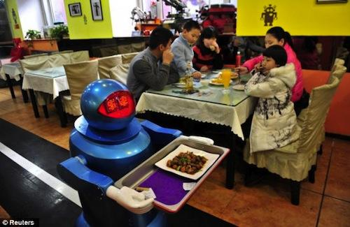 The Harbin Haohai Robot Company in China has developed a robotic restaurant staff and opened a restaurant that uses them to cook, greet clients, and wait tables. The robots, which are multicolored and travel around via sensors on the floor, cost about $31,000 to $47,000 and run on batteries with a five-hour life. The move is part of a growing trend toward service robots, a market that could outpace even industrial robots in the next several years.   (Source: Reuters)