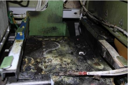 The auxiliary power unit (APU) battery area showed damage consistent with smoke, hot gases, and discharged electrolyte.   (Source: NTSB)