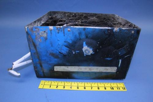 From the outside, the right side of the battery case enclosure showed the most damage.   (Source: NTSB)