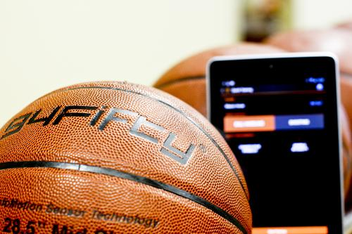 InfoMotion's smart basketball gathers information about shooting or dribbling, and then sends it wirelessly to a smartphone or tablet computer.   (Source: InfoMotion Sports Technologies)