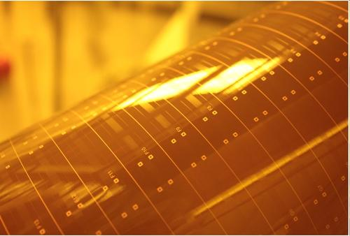 A new silicone-based material developed by Dow Corning and IBM promises to enable flexible, stable, and easily processable board-level optical waveguides, like the prototype shown here, for high-speed data transfer.  (Source: IBM Research)