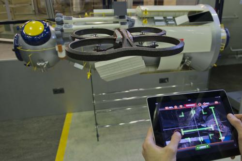 A free iPhone video game app turns your Parrot AR.Drone into a simulated spacecraft, which you can use to simulate docking on the International Space Station. You get points for accuracy and speed, and the European Space Agency gets tons of data to help make better space robots.   (Source: European Space Agency/Anneke Le Floc'h)