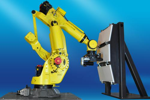A challenge with robots in aerospace manufacturing applications is the need to work with very large parts. Robotic work cells can be up to 30 ft to 40 ft long and several stories high.