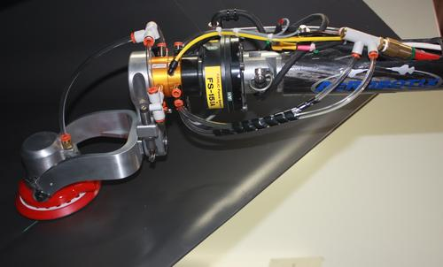A prototype robotic sanding tool from Aerobotix prepares to sand inside a combat aircraft inlet duct, using the integrated FANUC Force Sensor and ATI Quick Disconnect as part of the application force control solution.