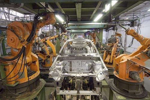 KUKA industrial robots hard at work.