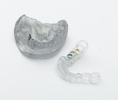 Stratasys' MED610 clear bio-compatible dental material is rated for up to 24 hours of contact with mucous membranes, and can be used with the Objet30 OrthoDesk printer to make devices such as customized surgical guides for dental surgery.   (Source: Stratasys)