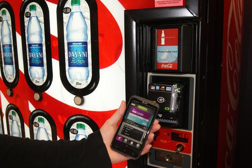 Coca-Cola is testing 200 vending machines outfitted with contactless readers that accept the Isis mobile payment solution, which relies on NFC technology.(Source: Isis)