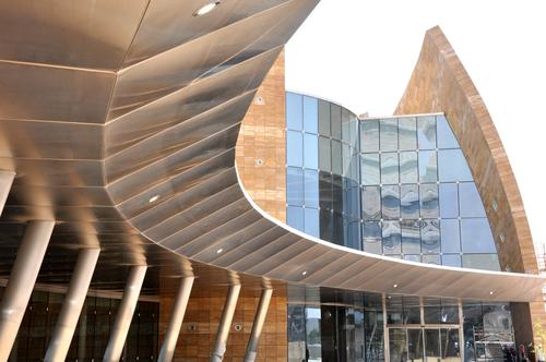 Composites are helping architects to make highly unusual curved and freeform shapes in large buildings in the Middle East, such as the Sidra Hospital under construction in Qatar on the Arabian peninsula. Roofing panels up to 15m to 25m (49 ft to 82 ft) long have been made with the material.   (Source: Affan Innovative Structures)