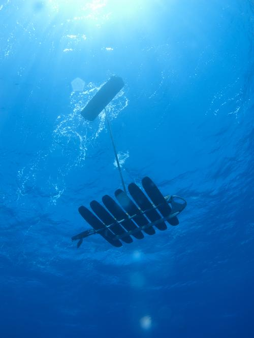 All Wave Glider autonomous unmanned marine vehicles (UMVs), including the new SV3 shown here, consist of a surfboard-sized float tethered to an underwater propulsion system that harvests energy from waves as the primary propulsion source.   (Source: Liquid Robotics)