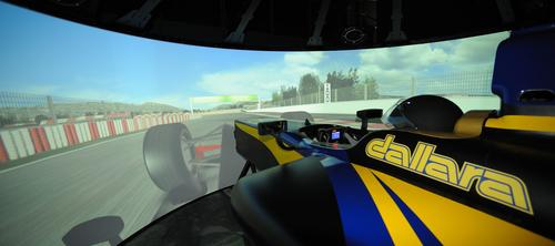 Moog's simulator enables professional drivers to see the road, feel the acceleration forces, and hear the roar of the engine.   (Source: Moog Inc.)