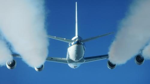 This photo, taken from a heavily instrumented HU-25C Falcon, shows the exhaust contrails from a DC-8 flying laboratory. NASA is testing the plane's emissions and performance as it flies onstandard jet fuel and on a biofuel blend.(Source: NASA/Eddie Winstead)