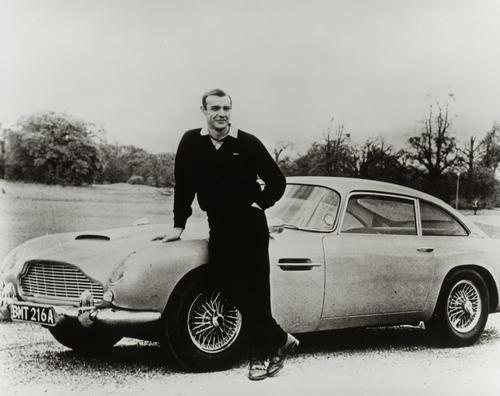According to movie legend, Aston Martin was initially reluctant to part with its Aston Martin DB5 for the filming of the 1964 James Bond film, Goldfinger. As a result, the producers had to pay for the prototype used in most of the scenes. The vehicle, considered to be the most famous in movie history, provided Bond with an assortment of gadgets, including revolving license plates, a GPS dashboard, armrest controls, smoke screen, oil slick, rear bullet-proof screen, front-wing machine guns and, of course, the ejector seat.   (Source: Aston Martin)
