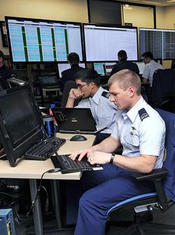 Cadet 3rd Class Zachary Madison (foreground) and Cadet 1st Class Ramon Villanueva take part in the National Security Agency's cyber defense exercise. The exercise, which took place in April, tested competitors' ability to defend a fully functioning computer network from attack.   (Source: US Air Force/Sarah Chambers)