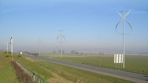 A visualization of X-Wind's vertical-axis wind turbines placed next to a road. The turbines could provide a renewable energy source to electric railways and in other places where there is limited access or restricted space.   (Source: X-Wind)