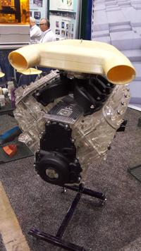 Forecast 3D showed off a replica it built of the classic Chevy Corvette LS7 small-block engine using rapid prototyping. Engineers used fused deposition modeling to print the intake manifold from an Ultem 9085 thermoplastic. They made the engine block in a two-step process -- employing stereolithography to build a master and then encapsulating it in silicone to create a mold. The company has used the mold to create 25 urethane castings of the block. The block replica is so detailed that it has real pistons, and oil can run through it.(Source: Design News)