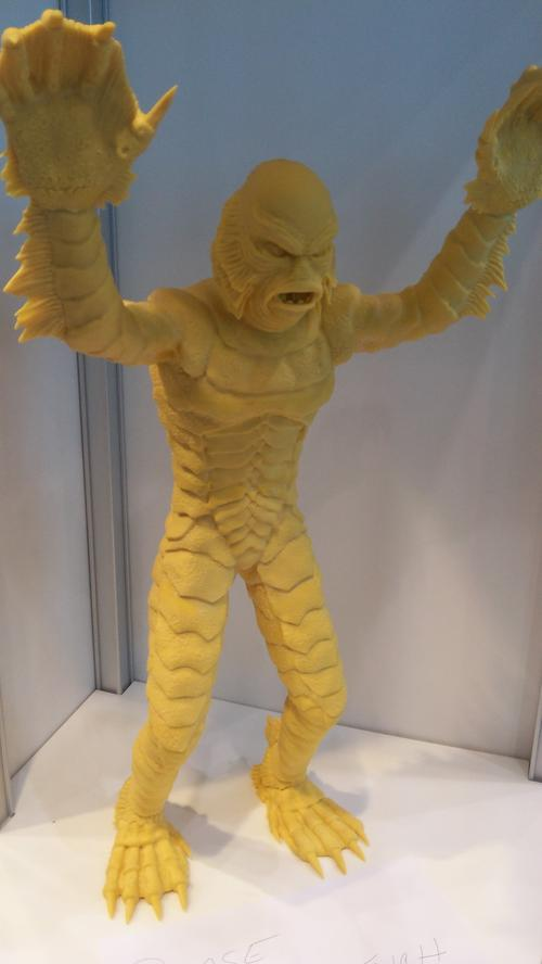 EnvisionTEC demonstrated its 3D printing technology with a 22-inch action figure based on the sci-fi flick The Creature From the Black Lagoon. Made from an engineered ABS plastic (acrylonitrile butadiene styrene), the figure was printed using digital light processing projector technology. Four printed pieces were glued together.(Source: Design News)