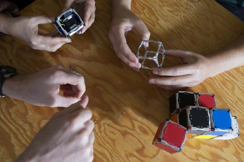 From left: M-Block modular robot without exterior panels, metallic frame including edge magnets, and several cubes attached to each other. (Source: M. Scott Brauer/MIT)