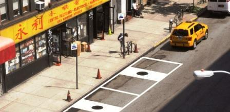 HEVO Power predicts that wireless charging stations (in the black circles that look like manhole covers) will enable electric delivery trucks to recharge in 'green loading zones.'  (Source: HEVO Power)