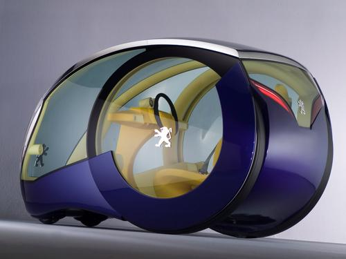 Winner of a Peugeot design competition in 2005, the Moovie Concept Car was designed for city dwellers who needed to fit into tight parking spaces. Each of its wheels were independently driven by their own electric motors, allowing the car to rotate on its own axis. The vehicle's two-passenger interior was designed for brightness and visibility. (Source: Wikicars.org)