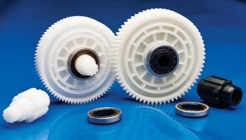 These injection-molded, high-precision plastic shafts and gears were made for a two-stage reduction transmission used in automotive power lift gates. The first-stage gear and shaft (far left and left) and second-stage output plastic gear (right) are injection molded from Celcon acetal copolymer (POM) M90 and Celcon GC25T, respectively. The second-stage output shaft (far right) is injection molded from Celstran PA 66-GF50-02.