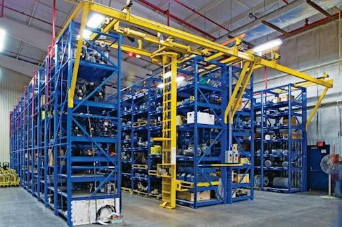 The STAK adjustable racking system is comprised of removable, adjustable pallets and a captive lifting and handling device. Offers increased load capacity and retrieval times in as little as two minutes.