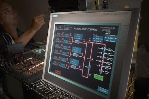 Norcimbus software engineer, Peter Golde, uses Siemens' TIA Portal to customize features on this touchscreen PLC. The integration of the Portal makes configurations for customers' specifications more seamless and user friendly.