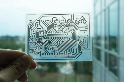 An Arduino circuit pattern printed on transparent PET film.